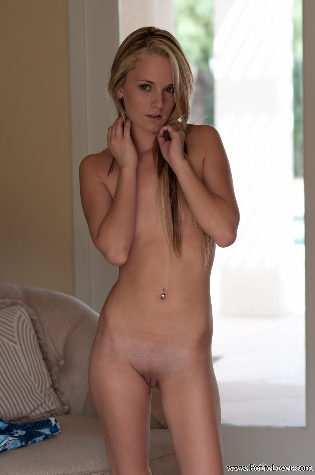 image Beautiful blonde spreads her tight pink pussy