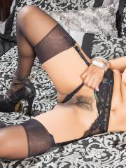 Latin hottie Gabby Quinteros masturbates in her black stockings on the bed