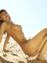 "Teen girl Alena displays her hot naked body on the beach in ""Goldy"""