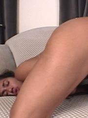 Brunette GF masturbates with her big dildo on the couch