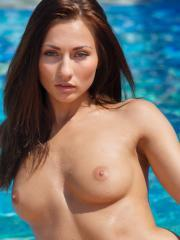 Beautiful girl Michaela Isizzu fondles her wet pussy by the pool