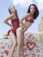 Beautiful teens Milena D and Korica A pleasure each other on the rocks