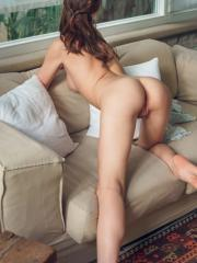 Blue-eyed cutie Barbara Vie stripteases in the couch