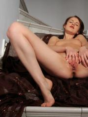Alice May pleasures her smooth and wet pussy on the stairs