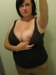 Chubby girlfriend takes selfshot pictures of her big natural tits in the mirror