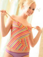 Perky blonde teen Skye teases in a sexy tiny colorful top and a purple thong