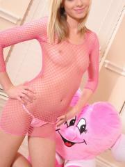 Blonde cock tease Skye shows off her perky teenage tits in a sexy slutty pink fishnet dress