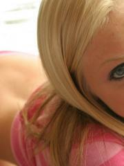 Teasing blonde teen Skye shows off her perky tits as she strips out of her pink striped shirt