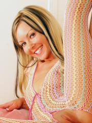 Aaliyah Love toys her tight pussy with a glass dildo in her rainbow fishnet bodysuit