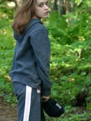 Spunky teen Serena teases outdoors as she goes for a walk in the forest