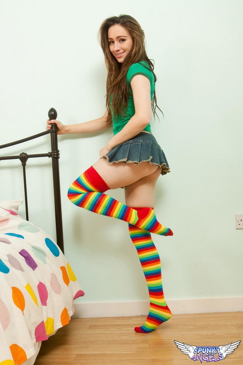 Brunette in colourful socks masturbates with a small toy