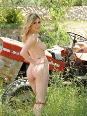 Blonde beauty Summer St Claire strips naked on the farm