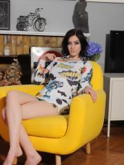 Beautiful girl Summer St Claire shows off her long legs and round boobs on the chair