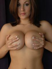 Busty babe Sweet Krissy poses and teases in pink
