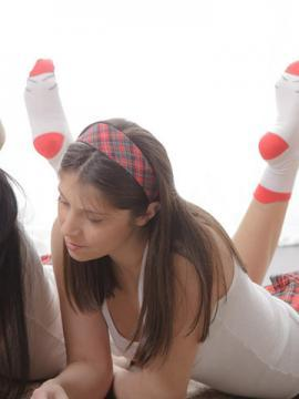 Hot schoolgirls Fatina and Betty enjoy some lesbian fun