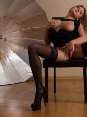 Viola Paige fingers her wet pussy in black lingerie
