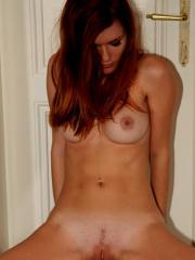 Gorgeous redhead Mia Sollis sprads her legs to give you her tight camel-toe pussy
