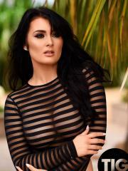 Hot model Ashleigh Gee strips out of her black striped bodysuit