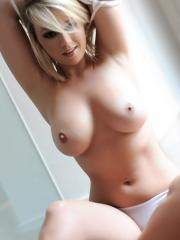 Melissa Debling shows off her massive natural breasts from her white lingerie