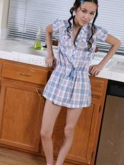 Hot teen Tiny Tabby gets naked in the kitchen