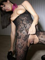 Pictures of hot brunette model Nadia stripping out of her black lace