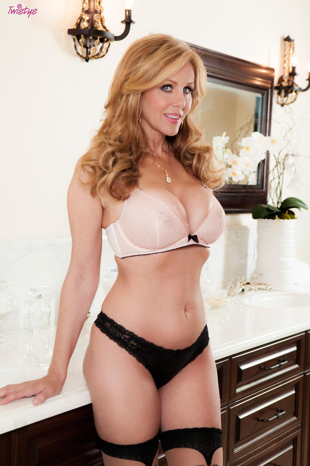 Busty milf julia ann shows her younger love her skills