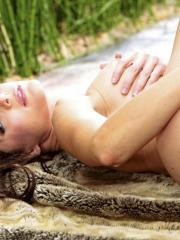 Jenni Lee strips outdoors and touches her moist pussy