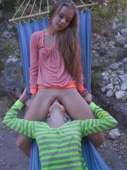 Hot girls Milena and Nika pleasure each other while camping