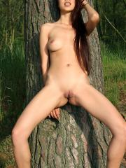Brunette girl Christy Charming strips down to her ugg boots outside in the forest