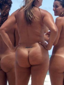 Assorted girlfriends get naked on the beach