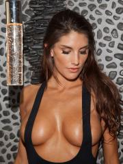Busty hottie August Ames strips out of her one-piece to show off her sexy body