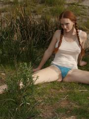 Pretty redhead teen Wendy Patton teases in her pigtails and panties