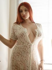Redhead hottie Gina Rosini shows you how gorgeous she looks in a white dress